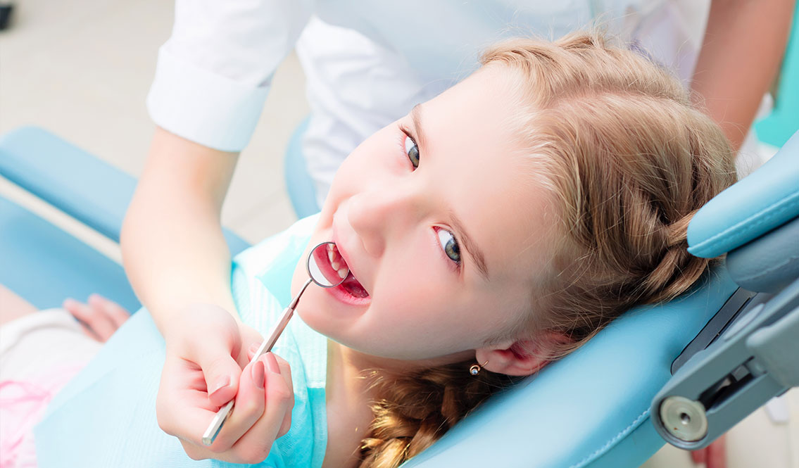 Girl getting examined - Pediatric Dentist in Colleyville, TX